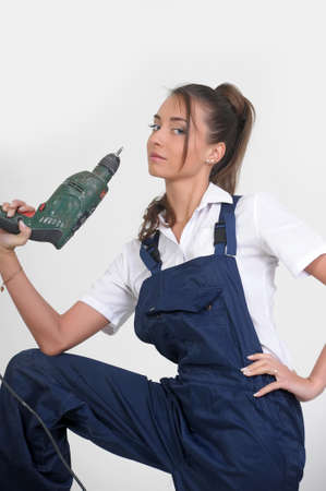 Beautiful girl with a drill Stock Photo - 13684034