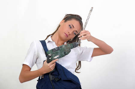 Beautiful girl with a drill photo