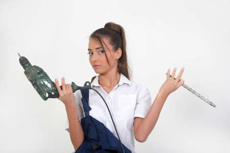 Beautiful girl with a drill Stock Photo - 13684268