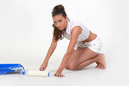 Woman with paint roller photo