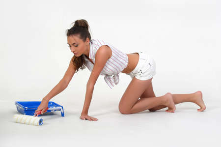 Woman with paint roller Stock Photo - 14494711