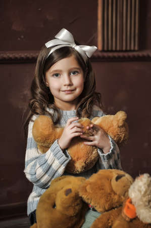 two persons only: little girl with toy bear-cubs