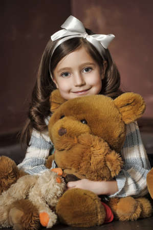 brown haired girl: girl with a bear-cub