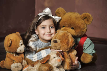 little girl with toy bear-cubs Stock Photo - 13682181