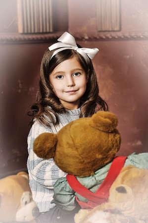 girl with a bear-cub photo