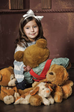 little girl with toy bear-cubs photo