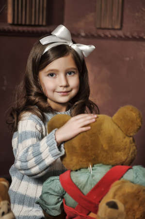 girl with a bear-cub photo