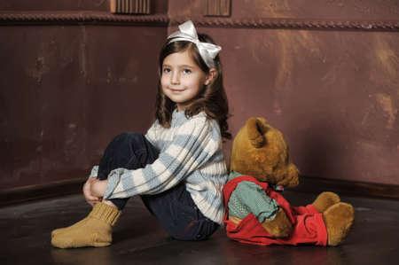 Girl with plush bear photo