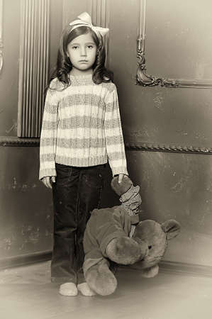 Girl with plush bear Stock Photo - 13682328