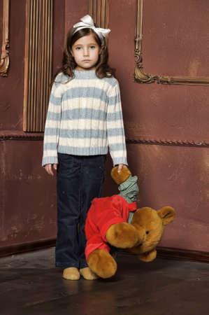 Girl with plush bear Stock Photo - 13682330