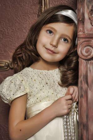 nude little girls: Vintage портрет маленькой девочки Фото со стока