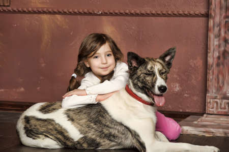 7 8 years: Portrait of a little girl with dog