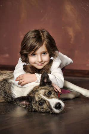 Portrait of a little girl with dog Stock Photo - 13681104