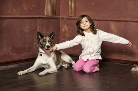 Portrait of a little girl with dog Stock Photo - 13682629