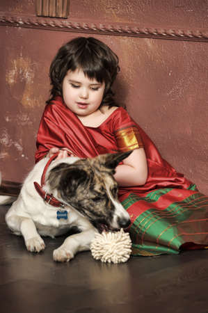 little girl in the national Indian suit with a dog photo
