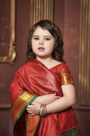a little girl is in the national Indian suit photo