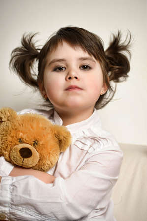 Little girl and her teddy bears  photo