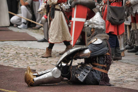 Weary knight sitting resting, historical festival in Vyborg, Russia