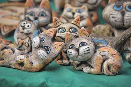 Ceramic figurines of funny cats
