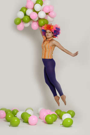 girl clown and balloons Stock Photo - 13683824