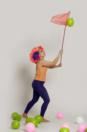 girl clown and balloons Stock Photo - 13683836