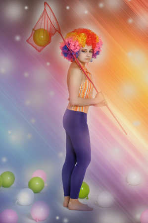 ni�a de payaso y globos photo