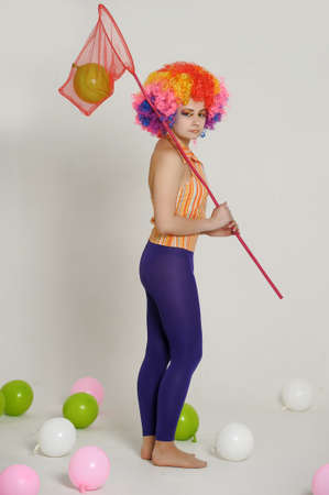 girl clown and balloons Stock Photo - 13683838