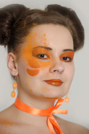 the girl with an orange creative make-up Stock Photo - 13682680