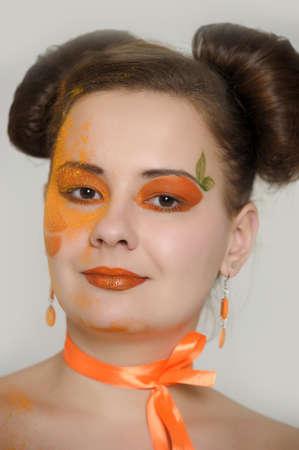 the girl with an orange creative make-up