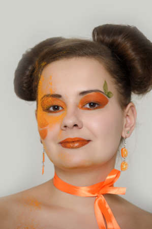 the girl with an orange creative make-up Stock Photo - 13682677