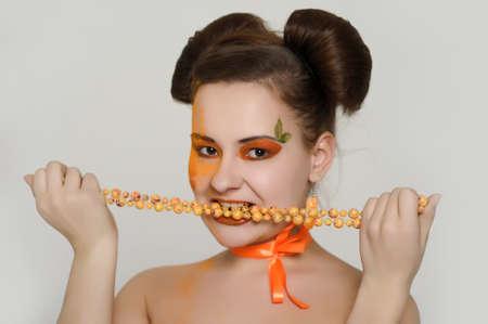 the girl with an orange creative make-up photo