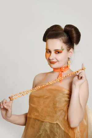 the girl with an orange creative make-up photo