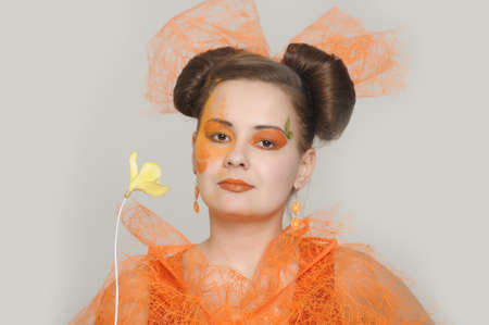 the orange girl with a yellow flower Stock Photo - 13682716