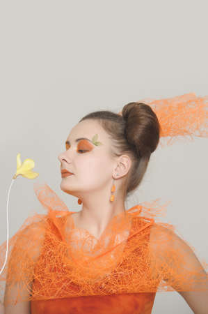 the orange girl with a yellow flower photo