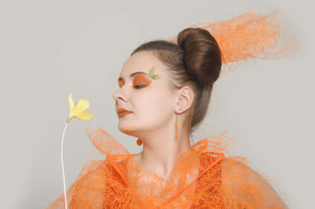 the orange girl with a yellow flower Stock Photo - 13682720
