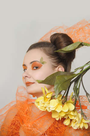 the orange girl with a yellow flower Stock Photo - 13682723