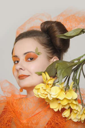 the orange girl with a yellow flower