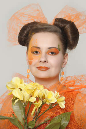 the orange girl with a yellow flower Stock Photo - 13682724