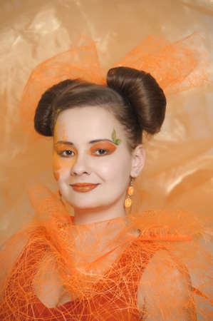the girl with an orange creative make-up Stock Photo - 13682706