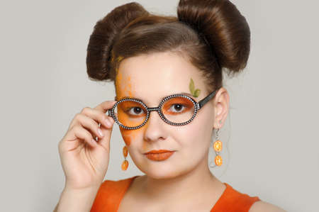 the girl with a bright make-up wearing spectacles