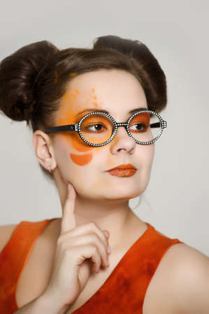 the girl with a bright make-up wearing spectacles Stock Photo - 13682893