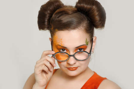 the girl with a bright make-up wearing spectacles Stock Photo - 13682889