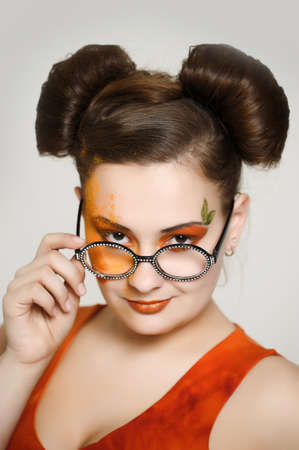 the girl with a bright make-up wearing spectacles Stock Photo - 13682897