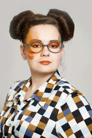 the girl with a bright make-up wearing spectacles photo
