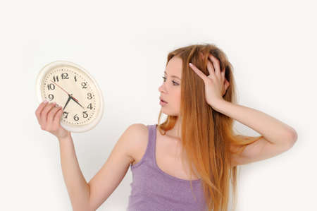 Young woman holding a clock Stock Photo - 13680017