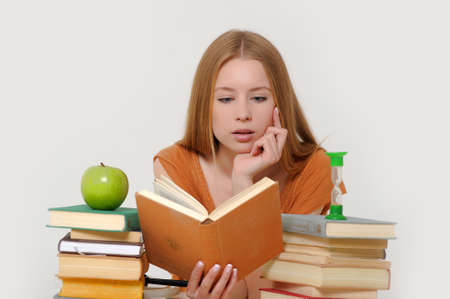 girl student with books, apple and sand-glasses Stock Photo - 13664033