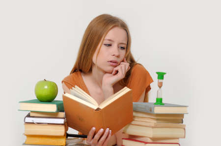 girl student with books, apple and sand-glasses Stock Photo - 13683009