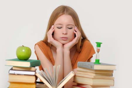 girl student with books, apple and sand-glasses Stock Photo - 13682999