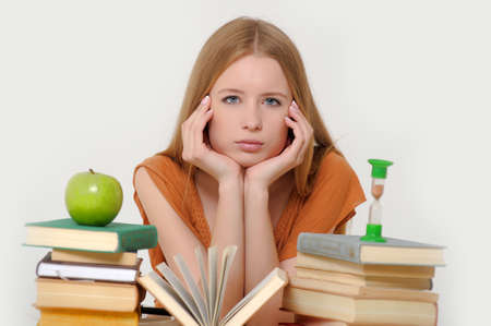 girl student with books, apple and sand-glasses Stock Photo - 13682998