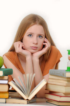 girl student with books, apple and sand-glasses Stock Photo - 13664042